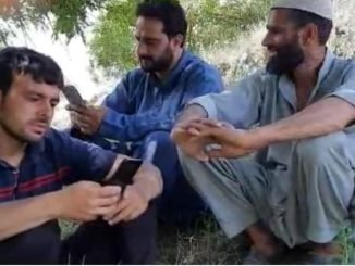 People using mobile internet amid gag in a Pulwama village bordering Budgam district